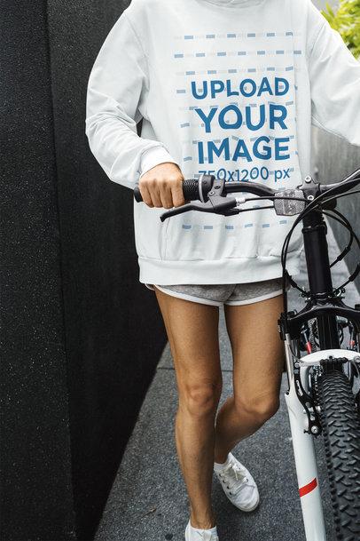 Hoodie Mockup Featuring a Woman Standing by Her Bike m4443-r-el2