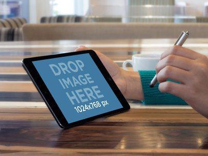 Black Landscape iPad Mini Being Held