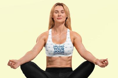 Sports Bra Mockup Featuring a Woman Meditating in a Studio m6500-r-el2