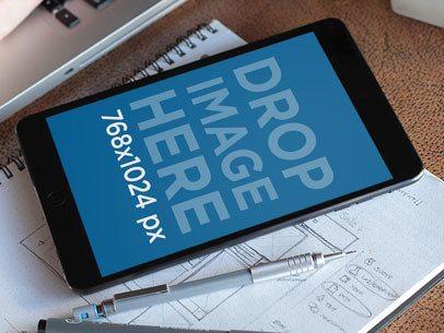 Black iPad Mini On Notebook