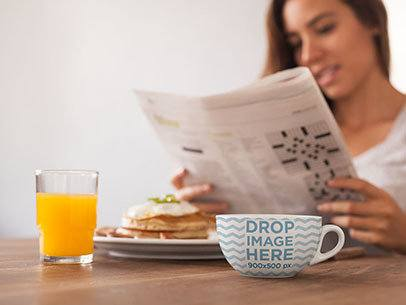 Cup Mockup of a Girl Reading the Newspaper While Having Breakfast a7033