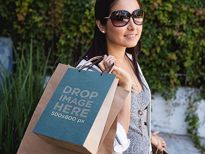 Paper Bag Mockup of a Woman Carrying a Set of Shopping Bags a6677