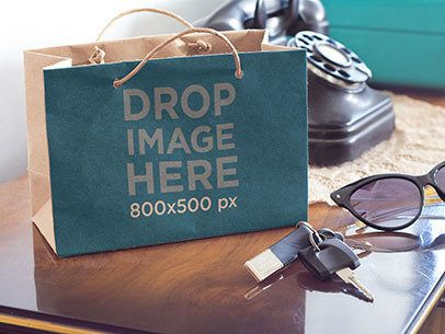 Paper Bag Mockup of a Shopping Bag Sitting on Top of a Table a6863