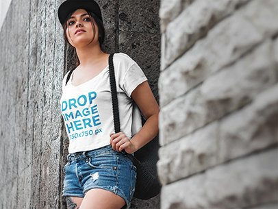 T-Shirt Mockup of a Girl Leaning Against a Stone Wall 5719a