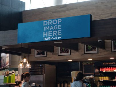 Horizontal Banner Mockup at a Coffee Stand in an Airport a10704