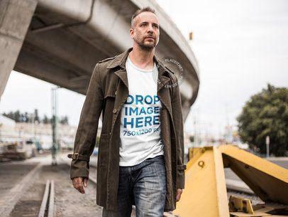 T-Shirt Mockup of a Man Walking Along a Railway a9371