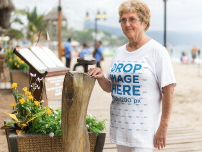 T-Shirt Mockup Featuring an Elder Woman at the Beach a10936