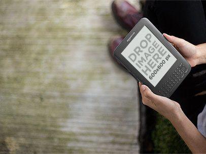 Young Man Holding a Kindle Outside Mockup a11836 print