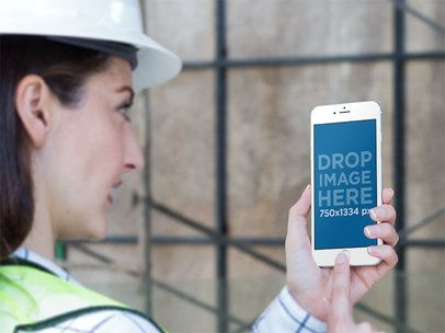 Mockup Featuring a Female Worker Staring at an iPhone in Portrait Position 12578standard