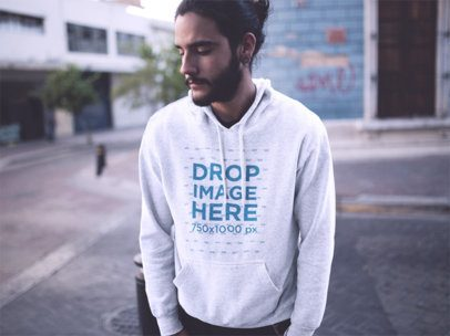 Hipster Man with Long Hair Wearing a Pullover Hoodie in a Downtown Street a12593