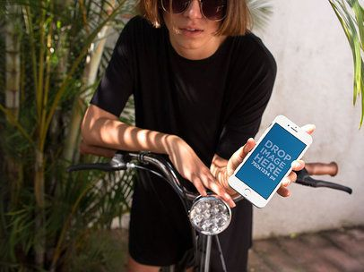 Mockup of a Woman in a Bike Showing Her iPhone Screen 12949