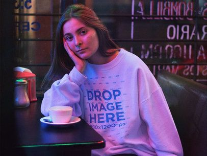 Crewneck Mockup Featuring a Lovely Girl Waiting in a Late Night Café a12688