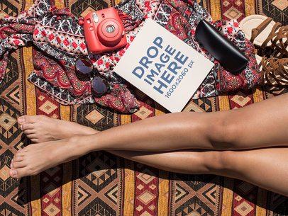 Mockup of a Book Lying Near a Girls Legs and Her Accessories While at the Beach a14294