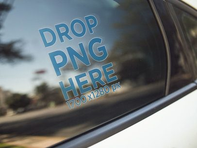 Mockup of a Window Decal on the Back Left Door of a White Car a14440