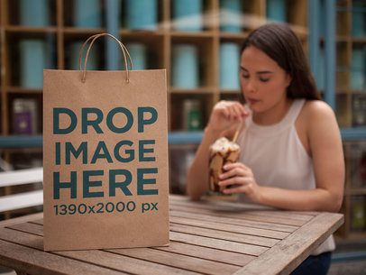 Paper Bag Template Standing on Table While Girl Drinks Frapuccino a14744