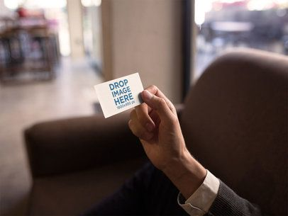 Business Man Holding a Business Card Mockup a15002