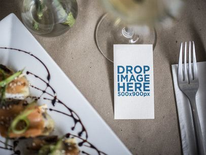 Vertical Business Card Mockup Next to a Gourmet Dish in a Restaurant a15034